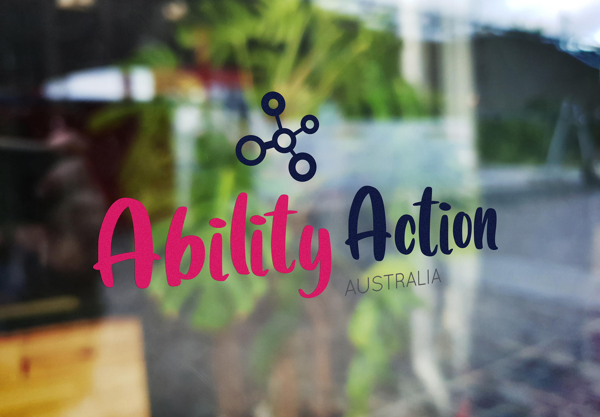 Ability Action Australia logo on window