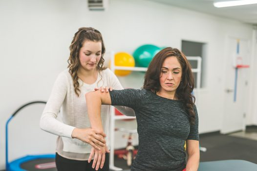 NDIS physiotherapy providers helping woman with arm or joint issue